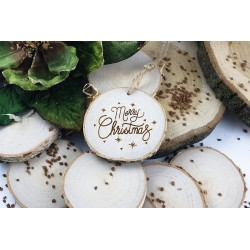 A slice of birch wood with Christmas engraving