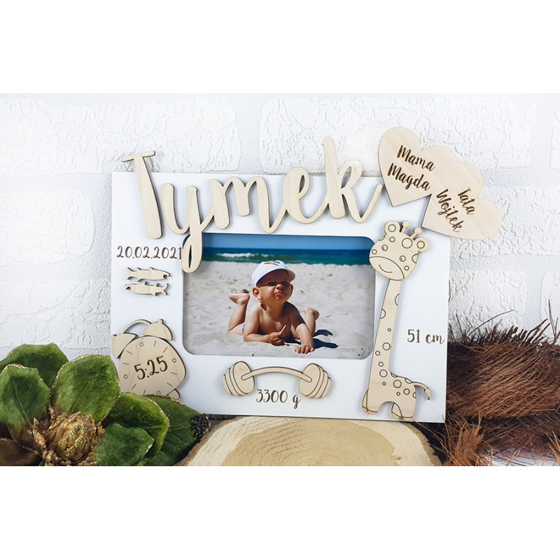 Photo frame with a birth certificate
