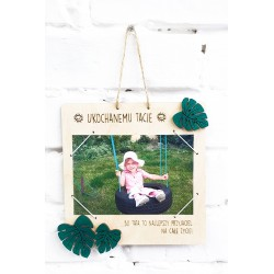 Father's Day gift. Photo frame with monstera leaves, dedication and name of the child.
